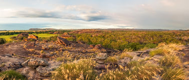 Rocky Escarpment and golden grasses -Kakadu panorama Stock Photo