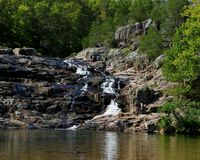 Rocky Falls park in Missouri. Rocky waterfall on a small creek in the Ozark mountains in southern Missouri Stock Images
