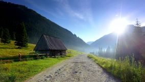 Rocky footpath in the valley Chocholowska at sunrise, Tatra Mountains. Poland stock footage
