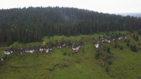 Rocky and forest terrain in the Ural mountains, Russia. Aerial view of green landscape in summer stock footage