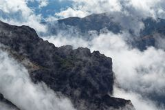 Rocky formation in the clouds on Portuguese island of Madeira. Rocky formation in the clouds. View from Pico do Arieiro on Portuguese island of Madeira stock image