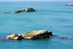 Rocky  formations in the sea. Relaxing nature view, space for text Stock Photo