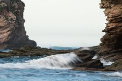 Rocky frame, cliffs of atlantic ocean with waves, abstract background. France Stock Photography