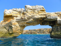 Rocky gate in stormy sea in Greece Stock Photos