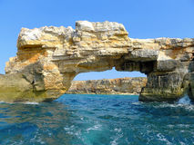 Rocky gate in stormy sea in Greece Stock Photography