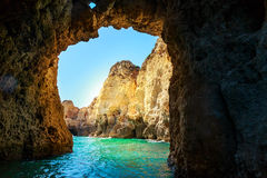 Rocky grotto in the sea Stock Images