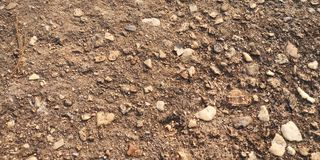 Rocky ground textured. Rocky ground surface texture background royalty free stock images
