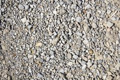 A rocky ground texture. A closeup photo of rocky ground texture stock photo