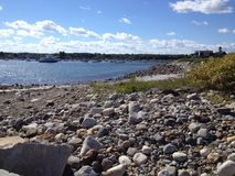 Rocky harbor shore Stock Images