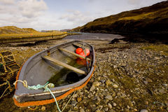 Rocky harbour. Fishing boat at Skullomie in north Scotland Stock Image