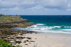 Rocky Headland in St Ives. The end of the beach in St Ives, Cornwall royalty free stock photography