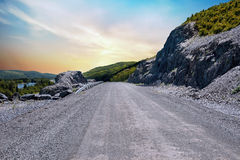 Rocky Highway. An unpaved, rocky road through the mountains in Edmundston, New-Brunswick Stock Photography