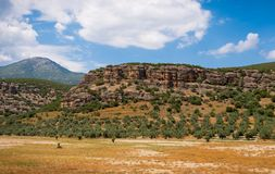 Rocky hill against blue cloudy sky. Peloponnes, Greece stock image