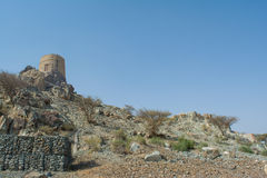 Rocky hill with ancient small castle on the top Stock Images