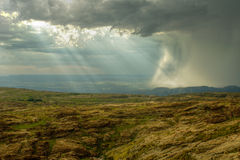 Rocky hill with heavy storm Stock Photography