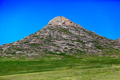 Rocky hill. Over clear blue sky background Stock Photos