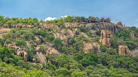 Rocky Hills of Gaborone. Lush green vegetation on the rocky hills at the outskirts of Gaborone, Botswana royalty free stock images