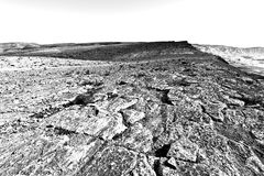 Stone Desert in Israel. Rocky hills of the Negev Desert in Israel. Breathtaking landscape of the desert rock formations in the Southern Israel Desert. Black and Stock Photography