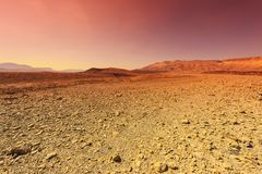 Middle East at sunset. Rocky hills of the Negev Desert in Israel. Breathtaking landscape and nature of the Middle East at sunset royalty free stock image