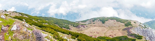 Rocky hills on the south slope of the Peca peak. Scenic view of the rocky hills on the south slope of the Peca peak, near the boundary of Slovenia and Austria Royalty Free Stock Photos