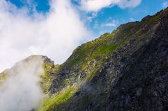 Rocky hillside of Fagars mountains in the cloud. Lovely mountainous scenery in summer stock photo
