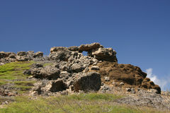 Rocky hilltop with structure. On tropical island of Bonaire Washington Park Slagbaai royalty free stock image