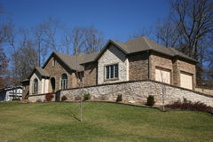 Rocky home. A home with extensive use of cultured stone for exterior cladding Stock Photo
