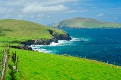 Irish Coastline and Great Blasket Island. The rocky Irish coastline with a view of Great Blasket Island, Dingle Peninsula, Ireland Stock Image
