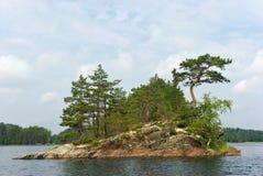 Rocky island. In the Pihlajavesi (Saimaa) lake. Finland Royalty Free Stock Photography