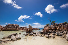 Rocky island. Island with granite rocks under a blue sky in the sea, Praslin, Seychelles Stock Images