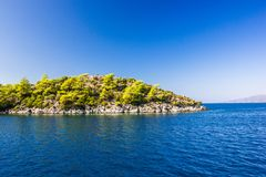 Rocky island in the Aegean sea on a clear day.  royalty free stock photography