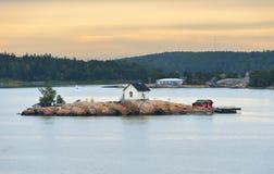 Rocky island in archipelago of Turku. Dawn Stock Photos