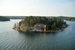 Rocky island in the Baltic sea with lighthouse royalty free stock photo