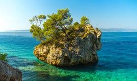 Rocky island in a beautiful blue sea, landscape Stock Photos