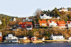 Rocky island with building, Norway Stock Photo