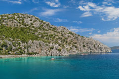 Rocky island in clear turquoise sea Stock Photography