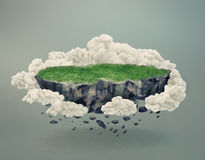 Rocky island covered by grass floating in midair Stock Photos