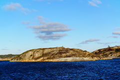 Rocky island in Fjord stock image