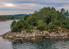 The rocky island in a fjord near Bergen , Norway. Royalty Free Stock Photography