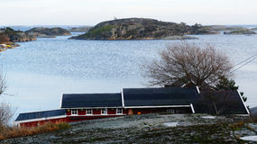 Rocky island on the fjord Stock Image
