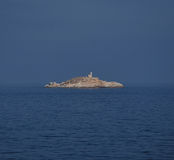 Rocky Palmaiola island with lighthouse, Elba Royalty Free Stock Photo