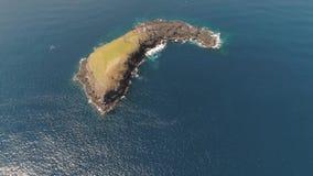 Rocky island in the ocean. stock video