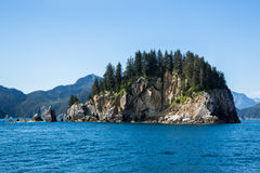 Rocky island off the coast of Seward, Alaska Stock Images