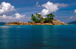 Rocky island with palm trees. St. Pierre rocky island near the North coast of Praslin, Seychelles stock photos