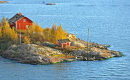 Rocky island with red houses Stock Photography