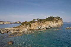 Rocky island. In the Sea of Japan Stock Photos