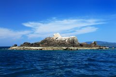 A rocky island in the sea Royalty Free Stock Images