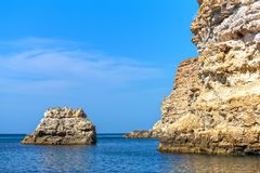 Rocky island in the sea stock photos