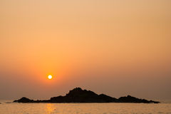 Rocky island silhouette and sunset in india Stock Photos