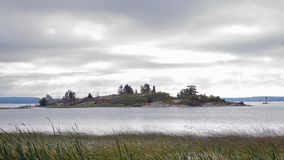 Rocky island on the St Lawrence River Royalty Free Stock Photography